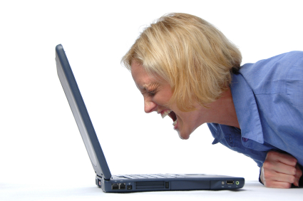Businesswoman screaming at her laptop