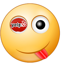 An emoticon with its tough sticking out and Yelp online marketing site logo as one of the eyes