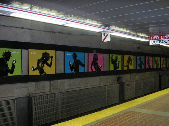 colorful ads for apple ipods in subway station