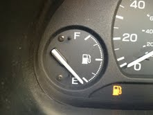 Car gas gauge below empty