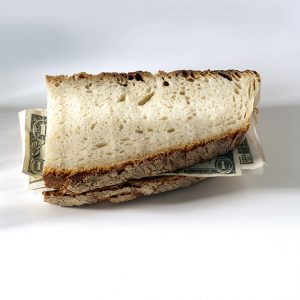 Dollar bill tucked inside a sandwich