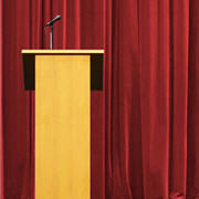 podium-in-front-of-red-curtain-featured-11-1-13