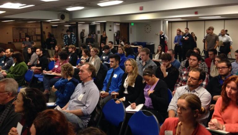 A filled room of students, marketers, and small business owners at MHVDM's seminar at SUNY New Paltz