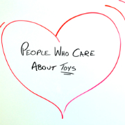 "Red hear with ""People Who Care About Toys"" written in center"