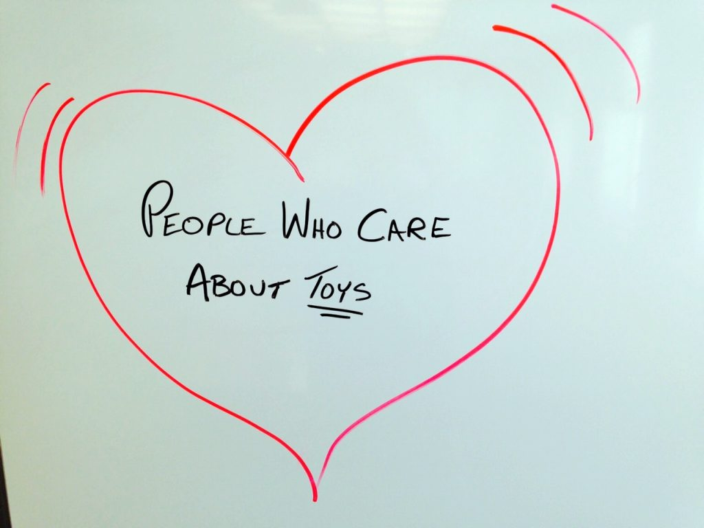 "heart with ""People who love toys"" written in it"