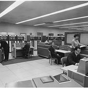 Employees working in a technology office.