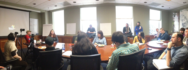 A conference room full of people listening to a presentation from Cindy Krum.