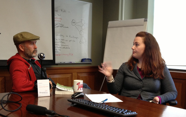 Cindy Krum talking to Ric Dragon in the conference room at DragonSearch