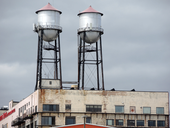 Two silos on the top of a concrete building