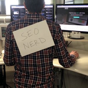Director of SEO, Jason White, with an SEO nerd sign stuck to his back
