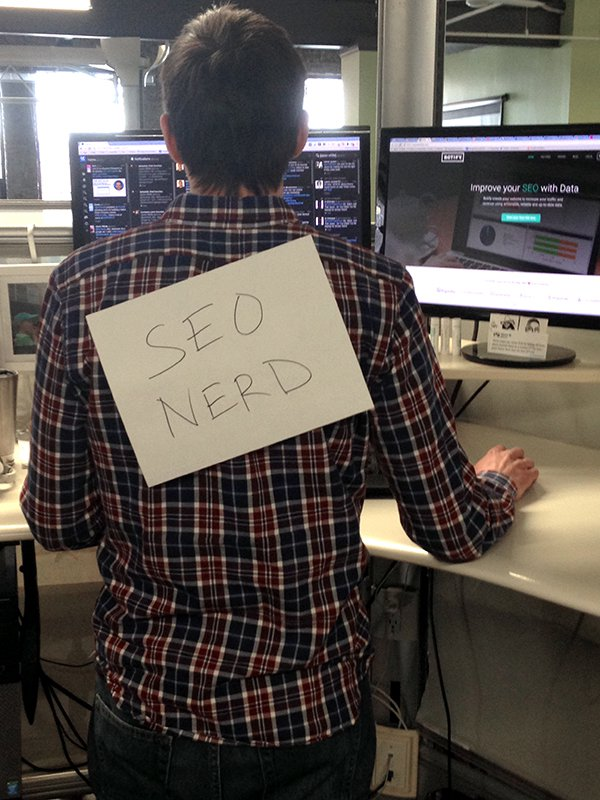 Jason wearing an SEO Nerd sign on his back while writing about social schema