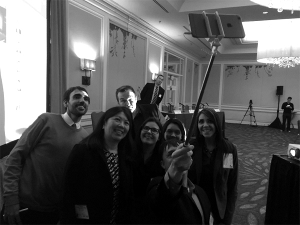 A group of speakers at the Social Tools Summit gather for a selfie