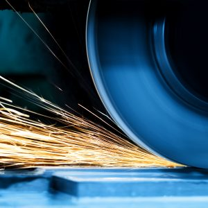 Sparks from grinding machine in workshop.