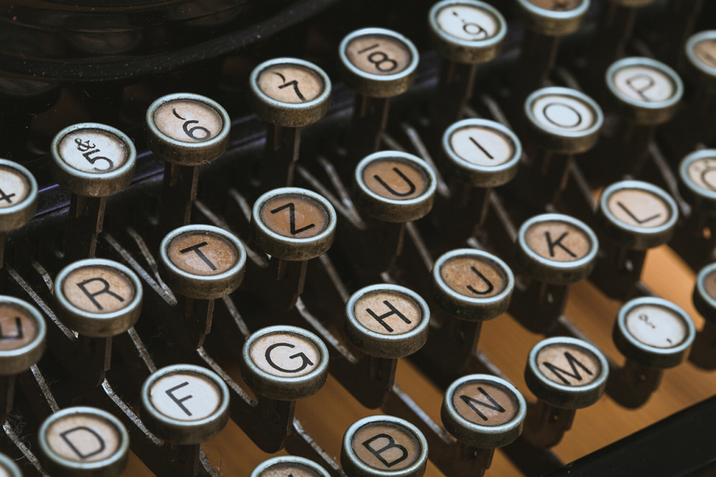upclose photo of old fashioned typewriter keys - Dragon360